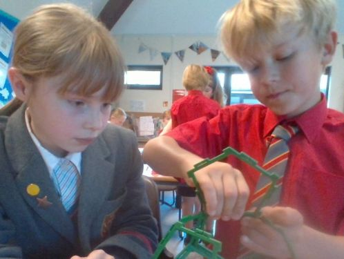 Year 5 explore the properties of 2 and 3 dimensional shape