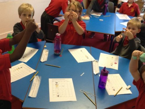 Year 2 squash, bend, twist and stretch different materials in science