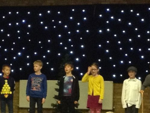 "Year 4 sparkle in their Christmas Production of ""Christmas Decorations"""