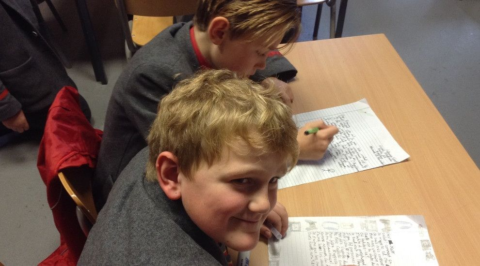 Year 6 write letters and cards to their new French pen pals